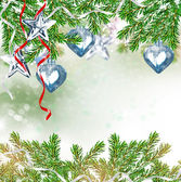 Christmas toy on a branch of spruce — Stock fotografie