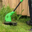 Man cutting the grass with electric trimmer — Stock Photo #57424587