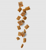 Cereal falling isolated on white background — Photo