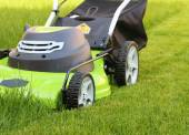 Cutting the grass with lawn mower — Stock Photo