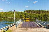 Road 471 to north Finland is crossed by cable ferry — Stock Photo