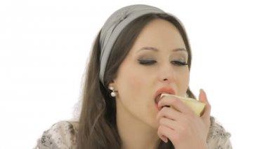 Lovely brunette enjoying the taste of an apple — Stock Video