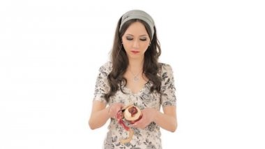 Pretty young woman peeling an apple — Stock Video