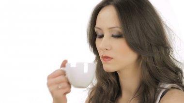 Lovely brunette enjoying the taste of the coffee — Stock Video