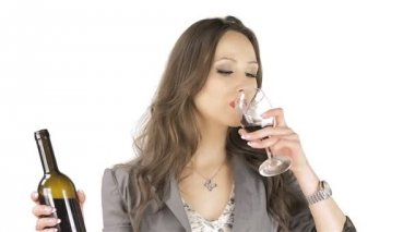 Lovely brunette with glass and bottle enjoying the taste of the red wine — Stock Video
