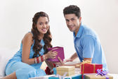 Couple with gift boxes — Stock Photo