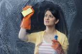 Woman cleaning a window — Stock Photo