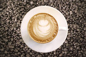 Hot Cappuccino with white cup on coffee beans — Foto Stock
