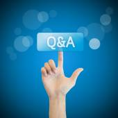 Q&A. hand man pressing questions and ask button. — Stockfoto