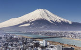 Mt. Fuji with cityspace view surreal shot. — Stock Photo