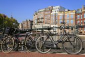 Canal and bicycle on bridge in Amsterdam — Stock Photo