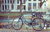 Bicycle in city near canal — Stock Photo