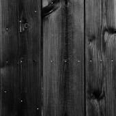 Gammal svart målad trä vägg - struktur eller bakgrund — Stockfoto