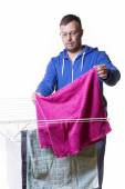 Man putting laundry — Stock Photo