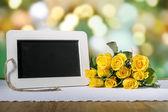Blank slate blackboard and roses — Stock Photo