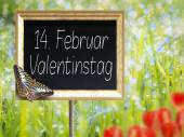 Chalkboard with german text 14. Februar Valentinstag — Stock Photo