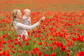 Mommy and daughter in a meadow — Stock Photo