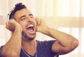 Exuberant man listening to his music — Foto de Stock