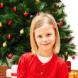 Portrait of little cute girl with Christmas present — Stock Photo #52726663