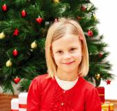 Portrait of little cute girl with Christmas present — Stock Photo