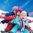 Winter fun, snow, happy children sledding at winter time — Stock Photo #55499825