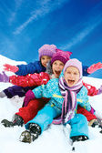 Winter fun, snow, happy children sledding at winter time — Stock Photo
