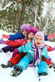 Winter fun, snow, happy children sledding at winter time — Stock Photo
