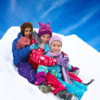 Winter fun, snow, happy children sledding at winter time — Stock Photo #56254101