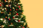 Decorated Christmas tree on the golden background — Stock Photo
