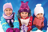 Group of children playing on snow in winter time — Stock Photo