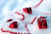 Christmas ornaments lie on the snow in winter — Stock Photo