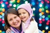 Happy family hugging the Christmas holidays  — Stock Photo