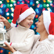 Happy family hugging the Christmas holidays — Stok fotoğraf #58242731