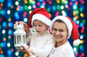 Happy family on a background of Christmas lights — Stock Photo
