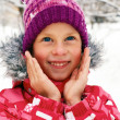 Delighted child in the street on the first day of winter. — Stock Photo #58871203