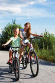 Two sisters On Cycle Ride In Countryside — Stock Photo