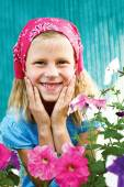 Vegetable garden - lovely young gardener with many flower — Stock Photo
