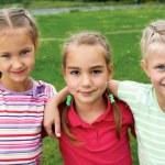 Group of different children having good summertime — Stock Photo #66400027