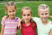 Group of different children having good summertime  — Stock Photo