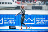 Triathlete Riveros after warm up in heavy rain before the start  — Stockfoto