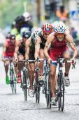 Cyclist with Godoy first and Buchholz in second on the wet cobbl — Stock Photo