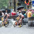 Постер, плакат: Triathletes Jonathan and Alistair Brownlee out of a curve on a w