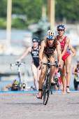 Sarah Groff from USA first out from the transition to cycling at — Stock Photo