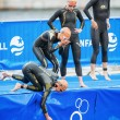 ������, ������: Triathletes preparing before the womens swimming in the cold wat