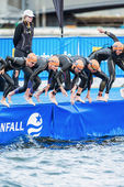 Triathletes starting in the womens swimming in the cold water at — Photo