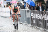 Melanie Santos from Portugal cycling in the rain at the Womans I — Zdjęcie stockowe