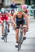 Mateja Simic from Slovakia first in a group cycling in the Woman — Stock Photo