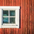 Square white window in old red wooden barn wall — Stock Photo #52837117