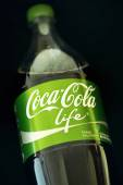 Coca Cola Life Pet bottle in green edition with lower amount of  — Stock Photo