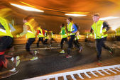 Stockholm Tunnel Run with runners passing by — Стоковое фото